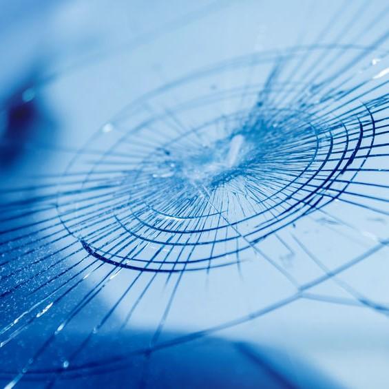 webbed crack in window glass