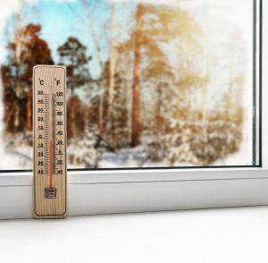 Thermometer Next to Window on Sunny Cold Day
