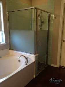 A Picture of a White Bathtub and Glass Shower.