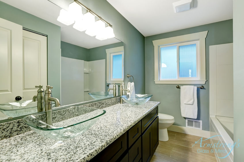 A Picture of a Wooden Vanity with Granite Countertop.